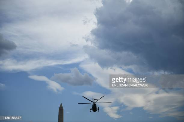 US President Donald Trump aborad Marine One departs the White House in Washington DC on July 17 2019 Trump travels to Greenville North Carolina for a...