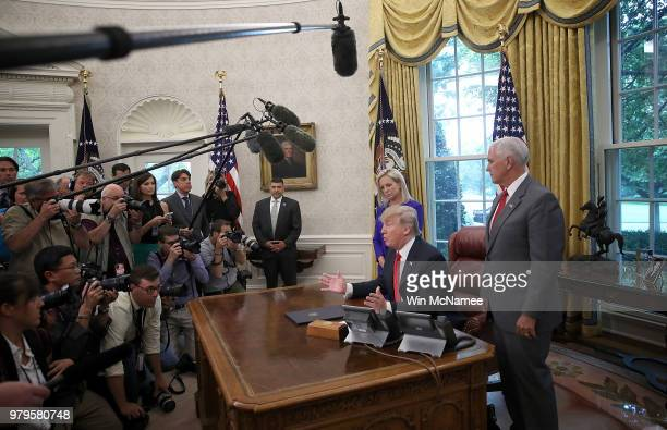 President Donald Trump, accompanied by Department of Homeland Security Secretary Kirstjen Nielsen and U.S. Vice President Mike Pence , answers...