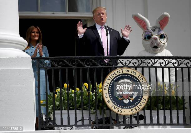 S President Donald Trump accompanied by first lady Melania Trump and a person dressed as the Easter Bunny welcomes guests with opening remarks during...