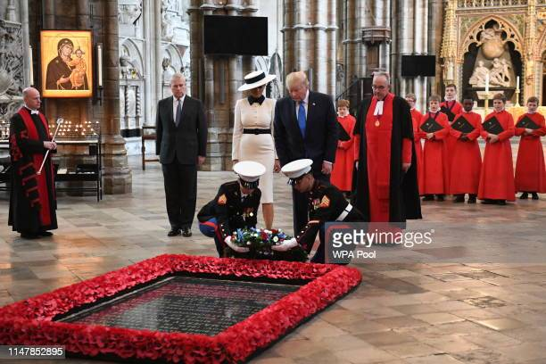 President Donald Trump accompanied by his wife Melania and Prince Andrew Duke of York places a wreath on the Grave of the Unknown Warrior during a...