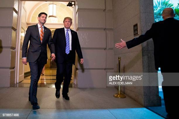 US President Donald Trump accompanied by House Speaker Paul Ryan arrives for a meeting with Republican members of Congress at the US Capitol in...