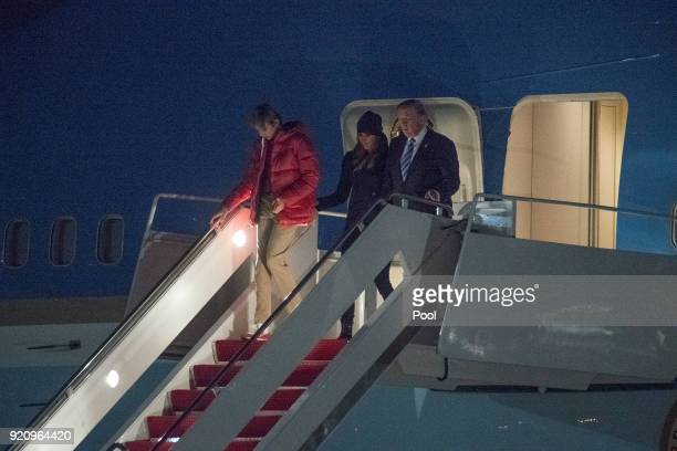 S President Donald Trump accompanied by son Barron Trump and first lady Melania Trump exits Air Force One February 19 2018 at Joint Base Andrews in...