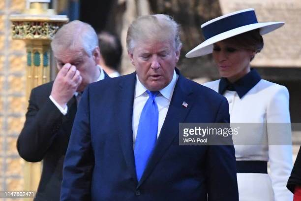 President Donald Trump accompanied First Lady Melania Trump and Prince Andrew Duke of York places a wreath on the Grave of the Unknown Warrior during...