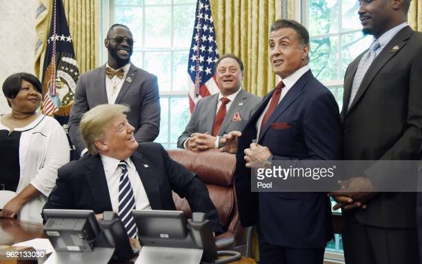 President Donald Trump acknowledges actor Sylvester Stallone after signing an Executive Grant of Clemency for former heavyweight champion Jack...