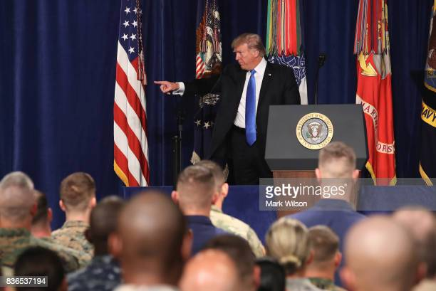 S President Donald Trump acknowledges members of the military before delivering remarks on Americas involvement in Afghanistan at the Fort Myer...
