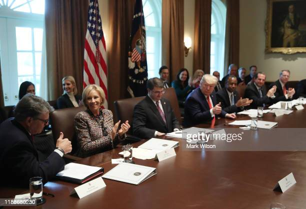 S President Donald Trump acknowledges outgoing Energy Secretary Rick Perry during a cabinet meeting at the White House on November 19 2019 in...