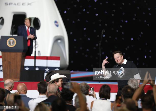 President Donald Trump acknowledges Spacex founder Elon Musk after the successful launch of the SpaceX Falcon 9 rocket with the manned Crew Dragon...