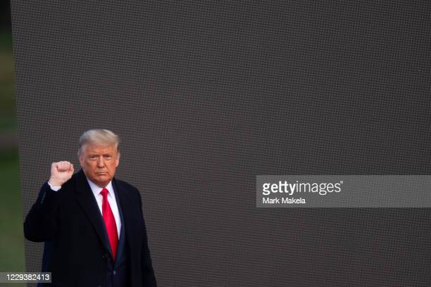 President Donald Trump acknowledges supporters after holding a campaign rally on October 31, 2020 in Newtown, Pennsylvania. With the election only...