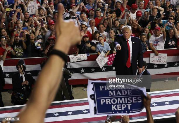 S President Donald Trump acknowledges supporters as he leaves after speaking at a Make America Great Again Rally at the Pennsylvania Farm Show...