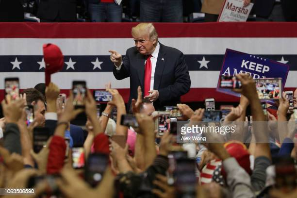 President Donald Trump acknowledges supporters during a campaign rally for Rep. Marsha Blackburn and other Tennessee Republican candidates at the...