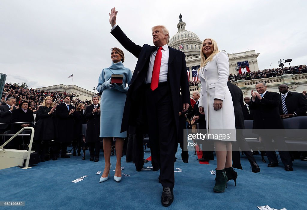 U.S. President Donald Trump acknowledges the audience after taking the oath of office as his wife Melania (L) and daughter Tiffany watch during inauguration ceremonies swearing in Trump as the 45th president of the United States on the West front of the U.S. Capitol in Washington, DC. January 20, 2017.