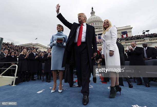 S President Donald Trump acknowledges the audience after taking the oath of office as his wife Melania and daughter Tiffany watch during inauguration...