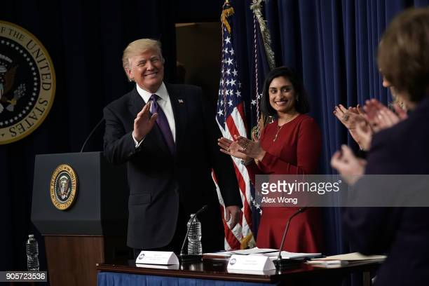 S President Donald Trump acknowledges the audience as Administrator of the Centers for Medicare and Medicaid Services Seema Verma looks on as he...