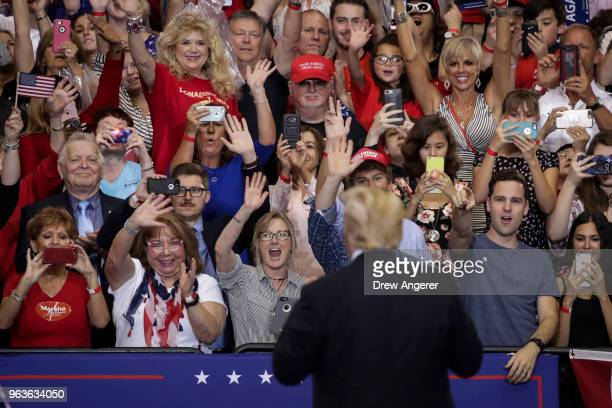 S President Donald Trump acknowledges the audience during a rally at the Nashville Municipal Auditorium May 29 2018 in Nashville Tennessee Earlier in...