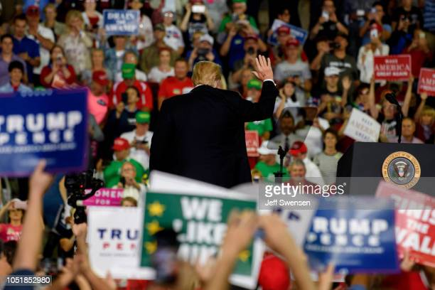 S President Donald Trump acknowledges the crowd after speaking at a rally at the Erie Insurance Arena on October 10 2018 in Erie Pennsylvania This...