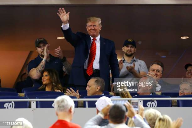 S President Donald Trump acknowledges the crowd during Game 5 of the 2019 World Series between the Houston Astros and the Washington Nationals at...