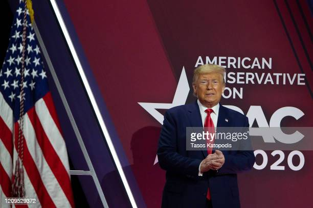 President Donald Trump acknowledges the crowd during the annual Conservative Political Action Conference at Gaylord National Resort Convention Center...