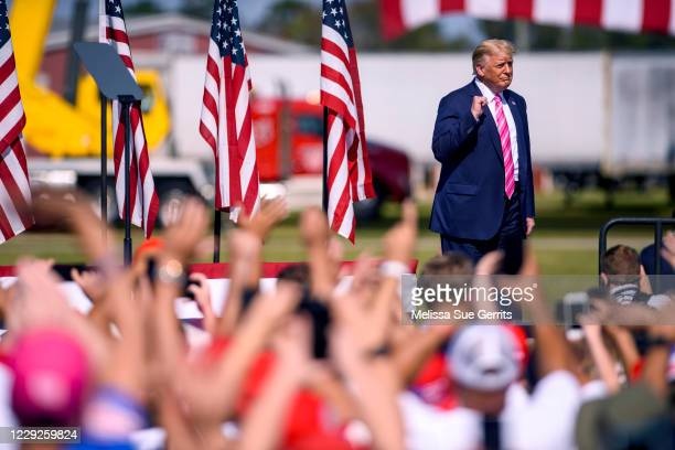 President Donald Trump addresses a crowd during a campaign rally on October 24, 2020 in Lumberton, North Carolina. President Trump has expressed his...