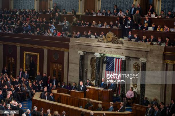 President Donald Trump addresses a joint session of Congress in the Capitol's House Chamber as Speaker Paul Ryan RWis right and Vice President Mike...