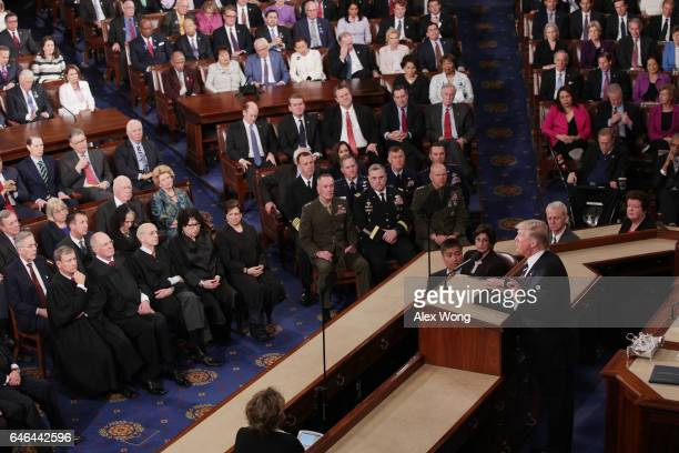 S President Donald Trump addresses a joint session of the US Congress on February 28 2017 in the House chamber of the US Capitol in Washington DC...