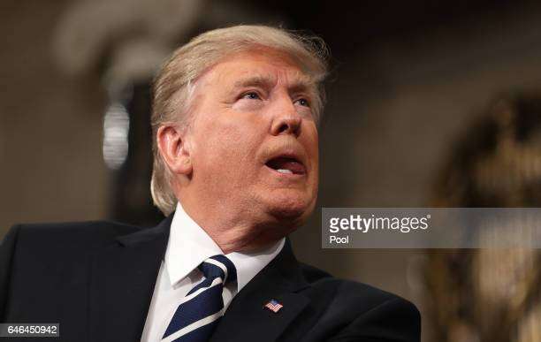 US President Donald Trump addresses a joint session of the US Congress on February 28 2017 in the House chamber of the US Capitol in Washington DC...