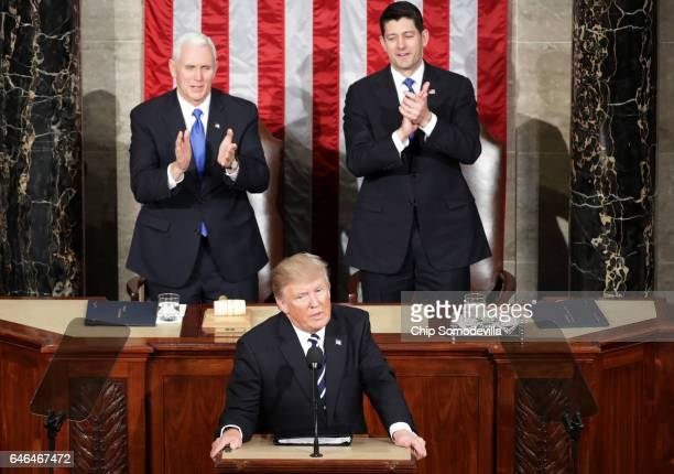 S President Donald Trump addresses a joint session of the US Congress as Vice President Mike Pence and House Speaker Rep Paul Ryan look on on...