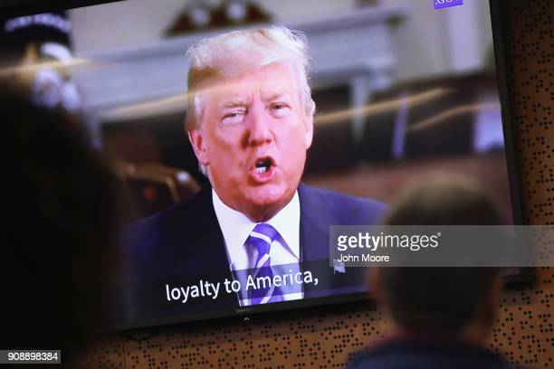 President Donald Trump addresses new American citizens on a taped video shown at a naturalization ceremony on January 22 2018 in Newark New Jersey...