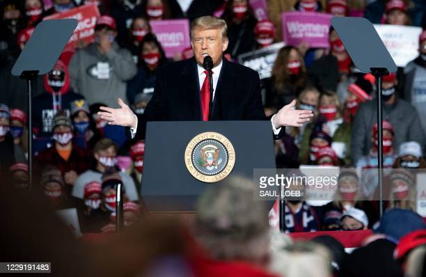 President Donald Trump addresses supoorters during a Make America Great Again rally as he campaigns at Erie International Airport in Erie,...