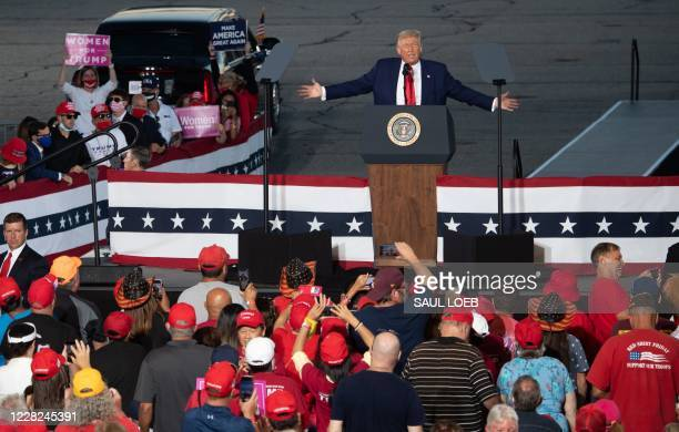 President Donald Trump addresses supporters during a campaign rally at Manchester - Boston Regional Airport in Londonderry, New Hampshire, August 28,...