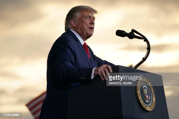 President Donald Trump addresses supporters during a campaign rally at Smith-Reynolds Regional Airport in Winston-Salem, North Carolina on September...