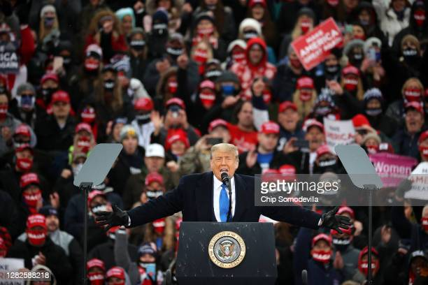 President Donald Trump addresses supporters during a campaign rally at Capital Region International Airport October 27, 2020 in Lansing, Michigan....