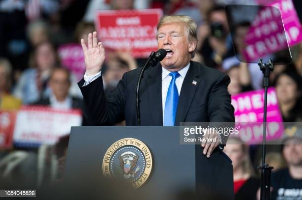 S President Donald Trump addresses the crowd during a campaign rally at the Bojangles Coliseum on October 26 2018 in Charlotte North Carolina...