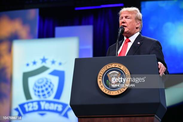 US President Donald Trump addresses the International Association of Chiefs of Police annual convention at the Orange County Convention Center in...