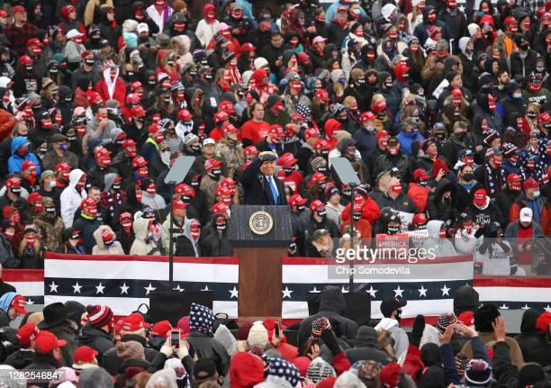 President Donald Trump addresses thousands of supporters during a campaign rally at Capital Region International Airport October 27, 2020 in Lansing,...