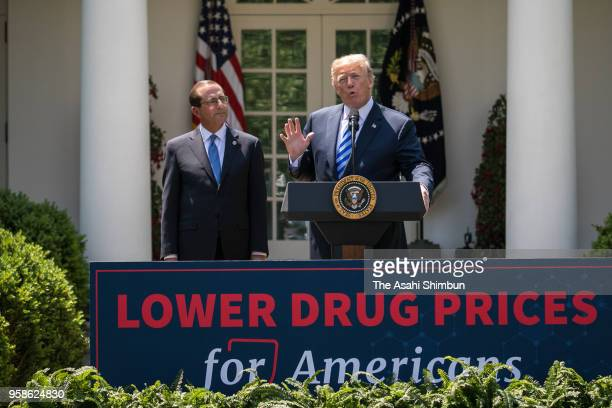 US President Donald Trump addresses while Health and Human Services Secretary Alex Azar listens following an announcement about drug prices in the...