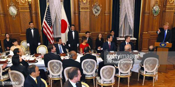 US President Donald Trump addresses while his wife Melania Japanese Prime Minister Shinzo Abe and his wife Akie listen during the dinner hosted by...