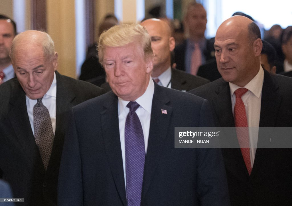 US President Donald Trump (C) along with White House Chief of Staff John Kelly (L) and Director of the National Economic Council Gary Cohn arrives for a meeting with House Republicans at the US Capitol on November 16, 2017. /