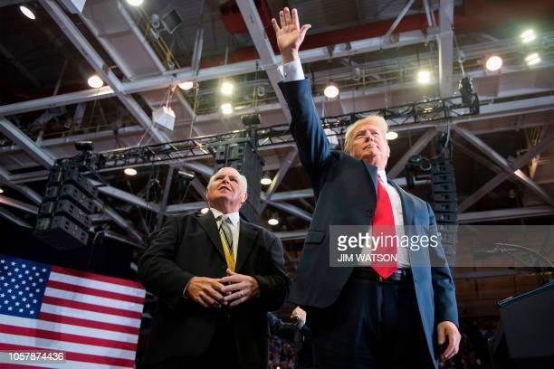 US President Donald Trump alongside radio talk show host Rush Limbaugh arrive at a Make America Great Again rally in Cape Girardeau Missouri on...