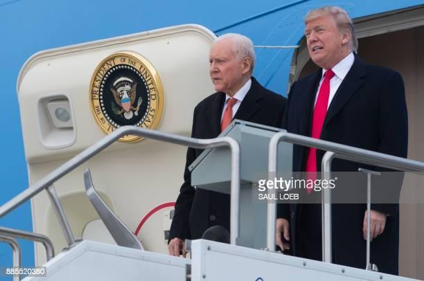 US President Donald Trump alongside US Senator Orrin Hatch Republican of Utah as they disembark from Air Force One upon arrival at Salt Lake City...