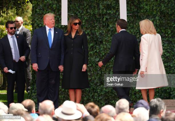 US President Donald Trump American First Lady Melania Trump French President Emmanuel Macron and French First Lady Brigitte Macron leave the stage...