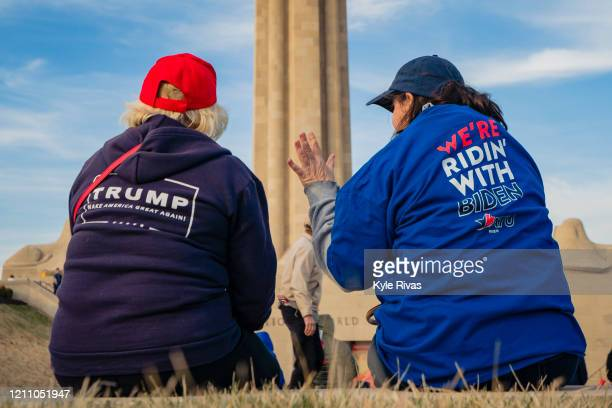 President Donald Trump and a former Vice President Joe Biden supporter converse before the Joe Biden Campaign Rally at the National World War I...