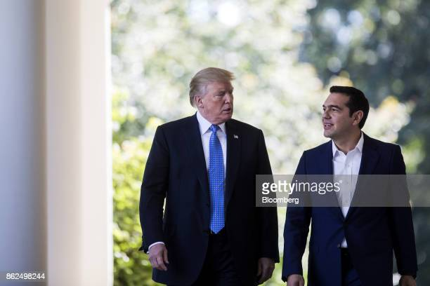 US President Donald Trump and Alexis Tsipras Greece's prime minister right exit the Oval Office before a joint press conference in the Rose Garden of...