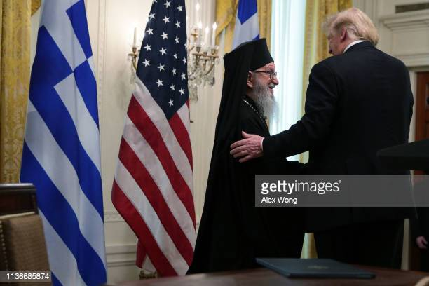 US President Donald Trump and Archbishop Demetrios Geron of America participate in a Greek Independence Day celebration at the East Room of the White...