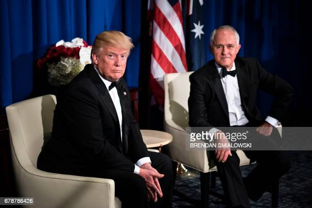 US President Donald Trump and Australian Prime Minister Malcolm Turnbull sit before a meeting onboard the Intrepid Sea Air and Space Museum May 4...