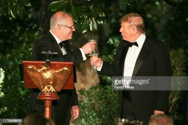 President Donald Trump and Australian Prime Minister Scott Morrison toast each other during a state dinner in the rose garden at the White House,...