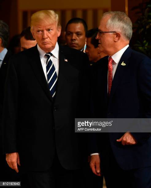 US President Donald Trump and Australia's Prime Minister Malcolm Turnbull talk as they arrive for the family photo on the first day of the G20 summit...