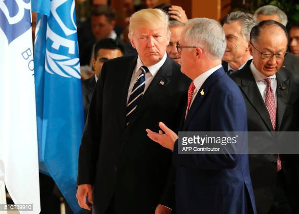 US President Donald Trump and Australia's Prime Minister Malcolm Turnbull as the President of the World Bank Group Jim Yong Kim looks on after the...