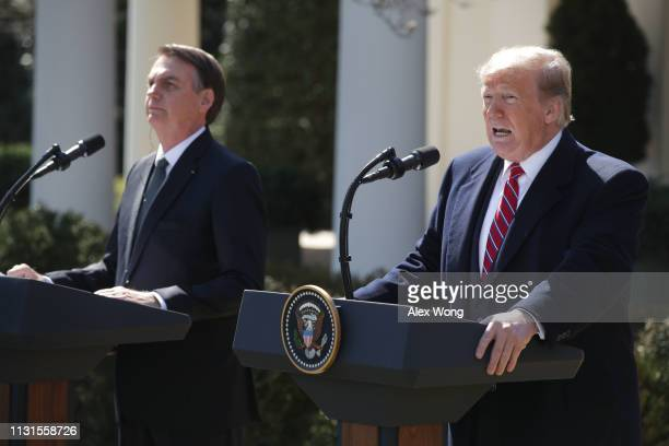 S President Donald Trump and Brazilian President Jair Bolsonaro participate in a joint news conference at the Rose Garden of the White House March 19...