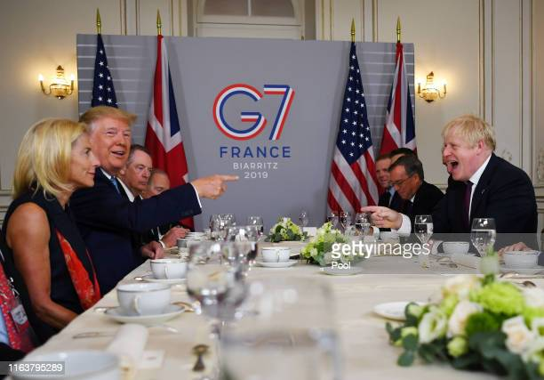 S President Donald Trump and Britain's Prime Minister Boris Johnson attend a bilateral meeting during the G7 summit on August 25 2019 in Biarritz...