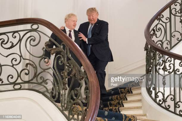 President Donald Trump and Britain's Prime Minister Boris Johnson arrive for a bilateral meeting during the G7 summit on August 25, 2019 in Biarritz,...